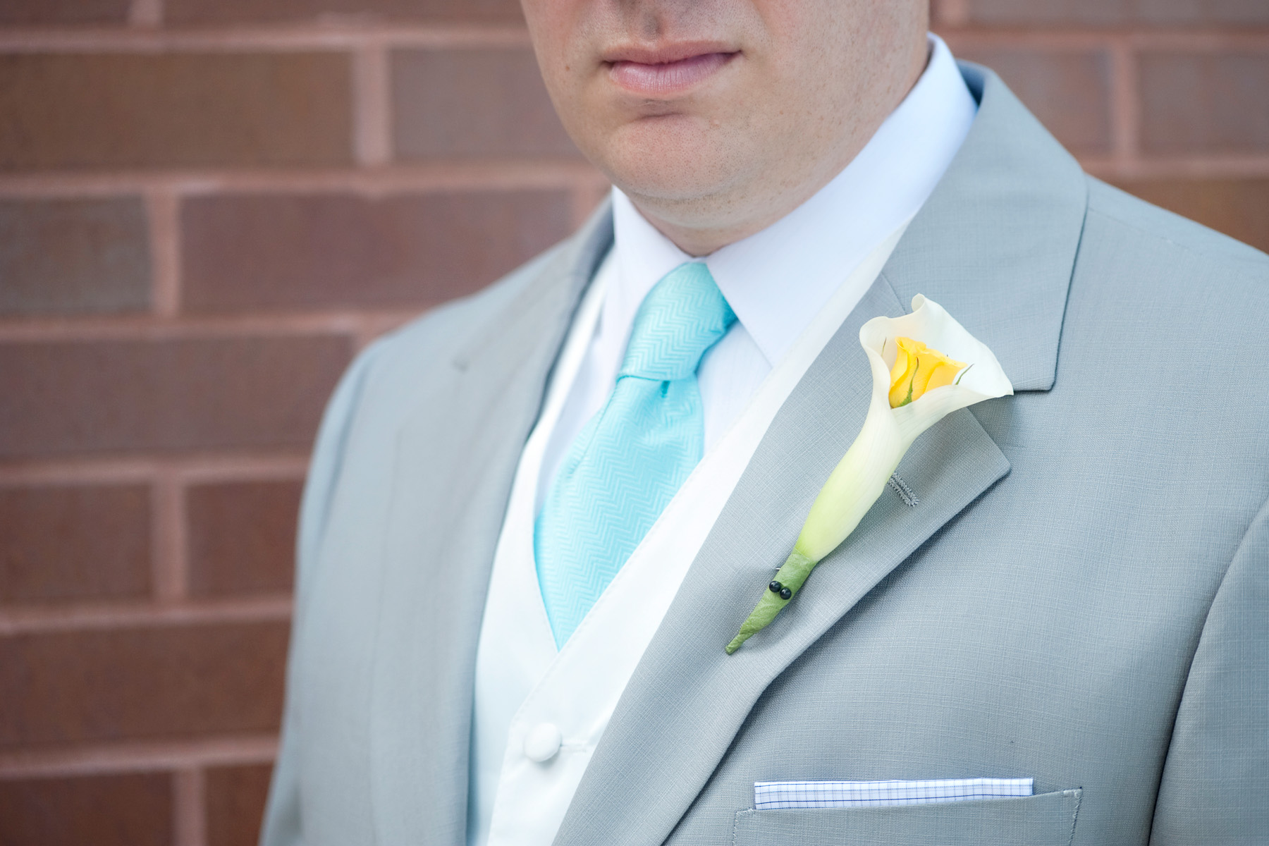 Close up of boutonnière on groom